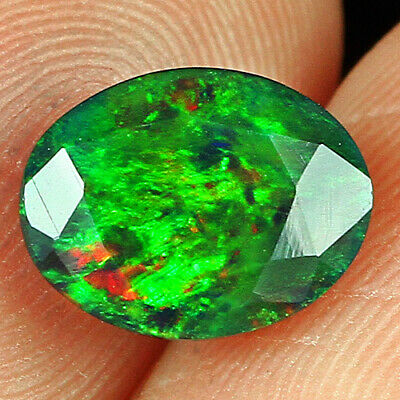 0.7ct Ethiopian Orange Opal Faceted Cut Play Of Color Mqoc320 Black Opals