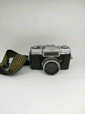 Mamiya Auto-lux 35 Camera With Leather Case And A Strap
