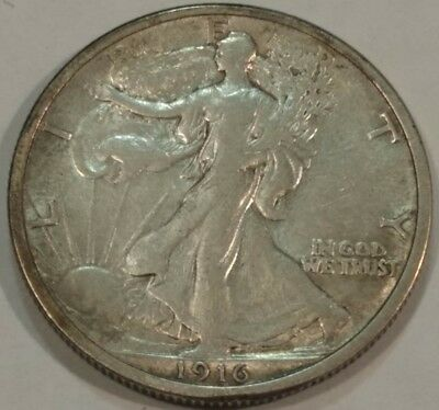 1916 XF-AU Walking Liberty silver half dollar.