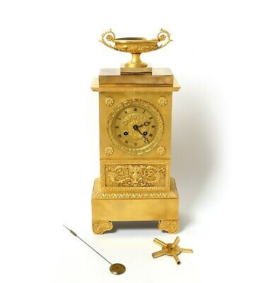 Mantel clock. Empire. Gold plated bronze. France, early 19th century.