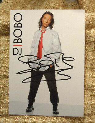 * * * * * DJ BOBO - world in motion * * * * * Autogramm auf .PK.