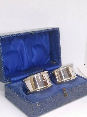 A pair of fully hallmarked solid silver napkin rings boxed