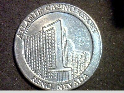 $1.00 Casino COIN Gaming Token - Atlantis Casino Reno NV-  Shell- Played- U0016