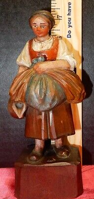 Wooden figurine of woman carring large load, hand carved, hand painted, detailed