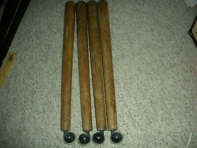 FOUR VINTAGE RETRO 1960`s WOODEN FURNITURE LEGS WITH ROUND CASTERS 55 cm