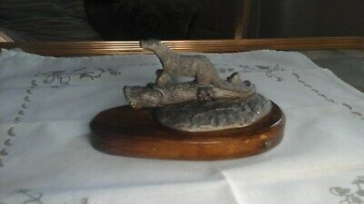 Pewter Figurine Of An Otter With A Fish On A Wooden Base