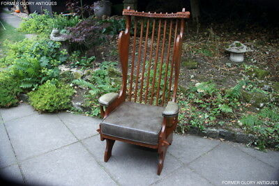 A Rupert Nigel Griffiths Carved Oak Derbyshire Wing Back Leather Seat Armchair