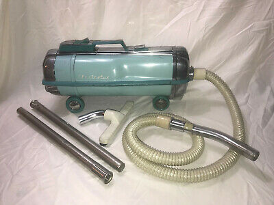 Vintage Electrolux  Canister Automatic Vacuum W/ Attachments, Wheels Retractable