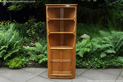 An Ercol Light Elm Corner Display Cabinet Cupboard Stand Table Shelves Bookcase