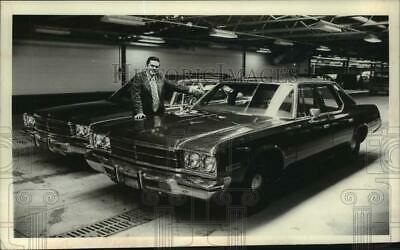 1978 Press Photo Charles LaHait with New York police vehicles to sell at auction