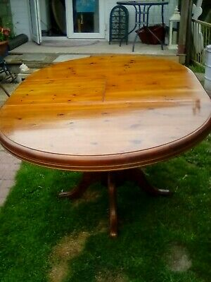 wooden extending dining table, please see pics