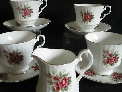 Vintage English china pink Rose Tea cups and saucers x 4 and a jug