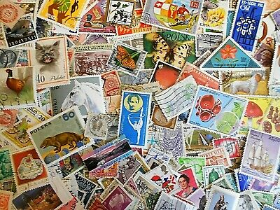 World wide collection.....more than 250 used stamps off paper
