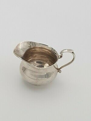 Solid silver milk jug by Addie brothers Ltd Birmingham 1939