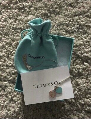 Authentic tiffany & Co. Double Mini heart necklace.And comes with box