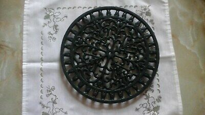 Unmarked Round Traditionally Decorated Green Cast Iron Three Footed Trivet