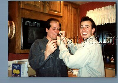 Gay Interest Photo R+4933 Man Smoking Pipe With Other In Kitchen