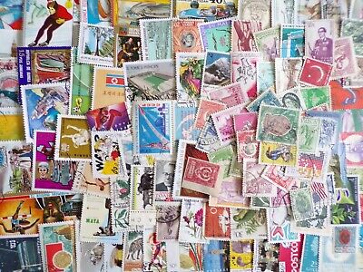 50g Worldwide kiloware stamps off paper: no GB : est 500+ stamps, many countries