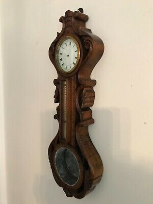 Victorian hand carved oak clock/barometer