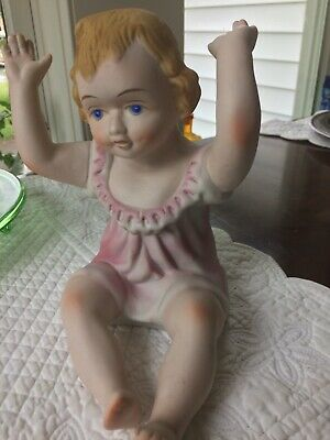Vintage Bisque Porcelain Piano Doll Sitting Baby Girl Pink Figurine