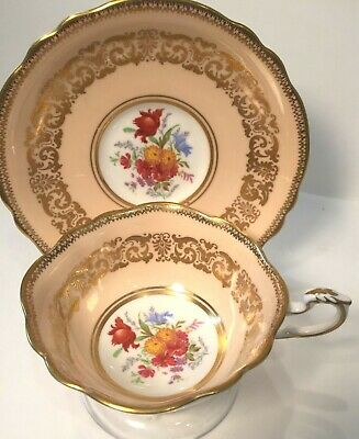 Paragon tea cup and saucer, peach, floral center design, filigree gold band,1939