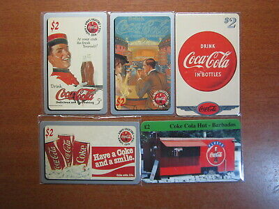 PHONECARDS COCA COLA  MINT & USED Phone cards x5 with protected Sleeves