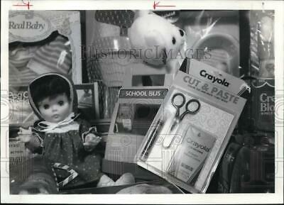 1986 Press Photo Toys including Crayola Cut and Paste, Doll and Bear - sya65428