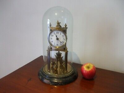 An Antique Glass Domed Anniversary Clock