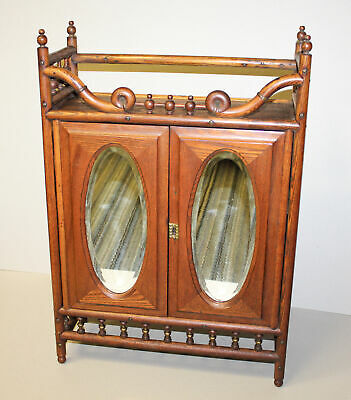 Antique Oak stick and ball Medicine Cabinet with two beveled oval mirrors