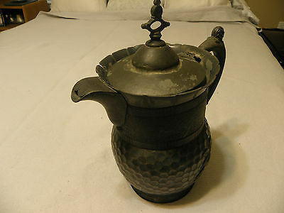 Antique hammered quadruple silver plated pitcher marked  Meriden B Co, Pat.1868