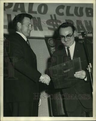 "1963 Press Photo Bob Stevens Awards ""Manager of the Year"" Plaque to Alvin Dark"