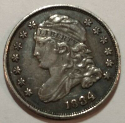 1834 Capped Bust US silver dime. XF, scuffy.