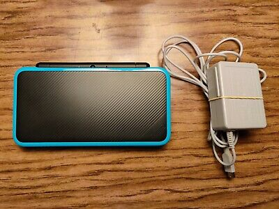 New nintendo 2ds xl black w/ charger and 4gb micro SD card