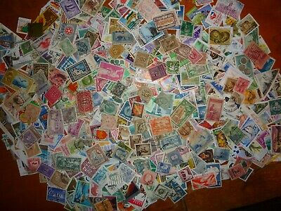 1000 World stamps taken from old stamp albums - all different