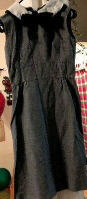 This is a vintage women's 60's dress in good condition.