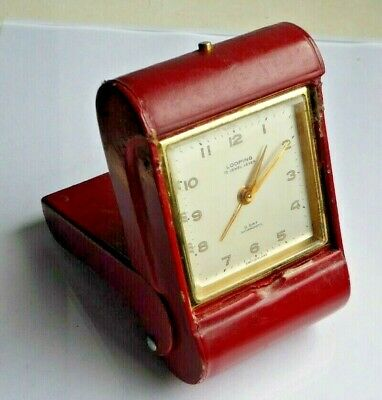 Looping 8 day travel alarm clock, red leather, working well, 15 jewels, compact.