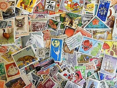 World wide stamps ...more than 1000 used stamps off paper