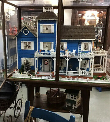 Victorian Dollhouse On Table In Showcase With Furniture Light Up