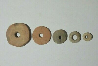 Ancient  Artifacts.  Clay Spinning Wheels