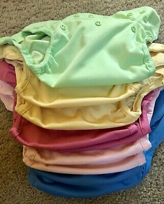 Flip cloth diaper lot with 9 covers, 30 inserts, and a Grovia wet bag.