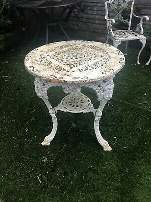 Small round cast iron garden table with faces details Vintage HEAVY