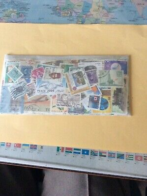Stamps world wide lot of 50 grams unsorted off paper