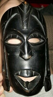 Hand carved wooden tribal mask made in India about 8 inches tall