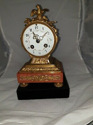 Stunning 19th Century Antique French Ormolu clock set on Red Marble.