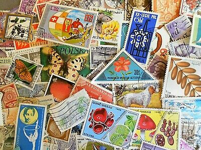 World wide collection....more than 500 used stamps off paper
