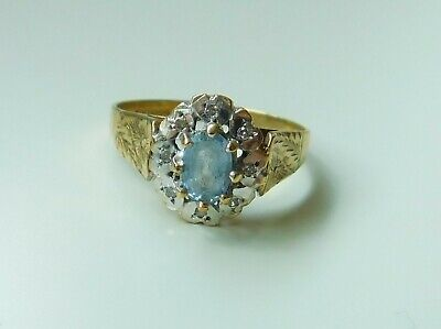 A 9ct GOLD TOPAZ AND DIAMOND STONE SET RING