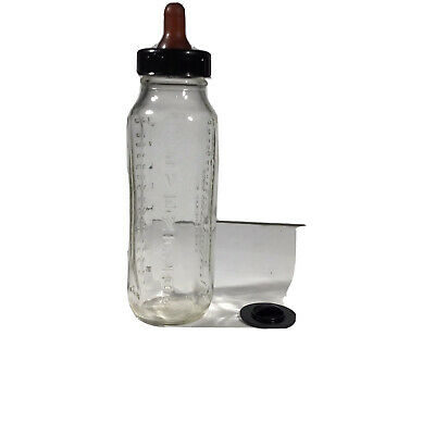 VINTAGE EARLY 1950s EVENFLO GLASS BABY BOTTLE With Nipple & Black Lid