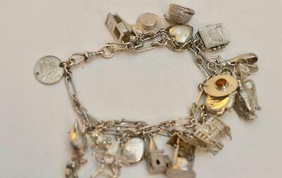 A Vintage Solid sterling silver charm bracelet 19 Charms pocket watch chain