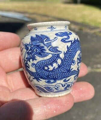 A rare 18th Century Chinese crackle glazed blue and white Dragon snuff bottle