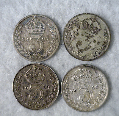 GREAT BRITAIN 3 PENCE COLLECTION : 4 SILVER COINS  ( stock# 439)